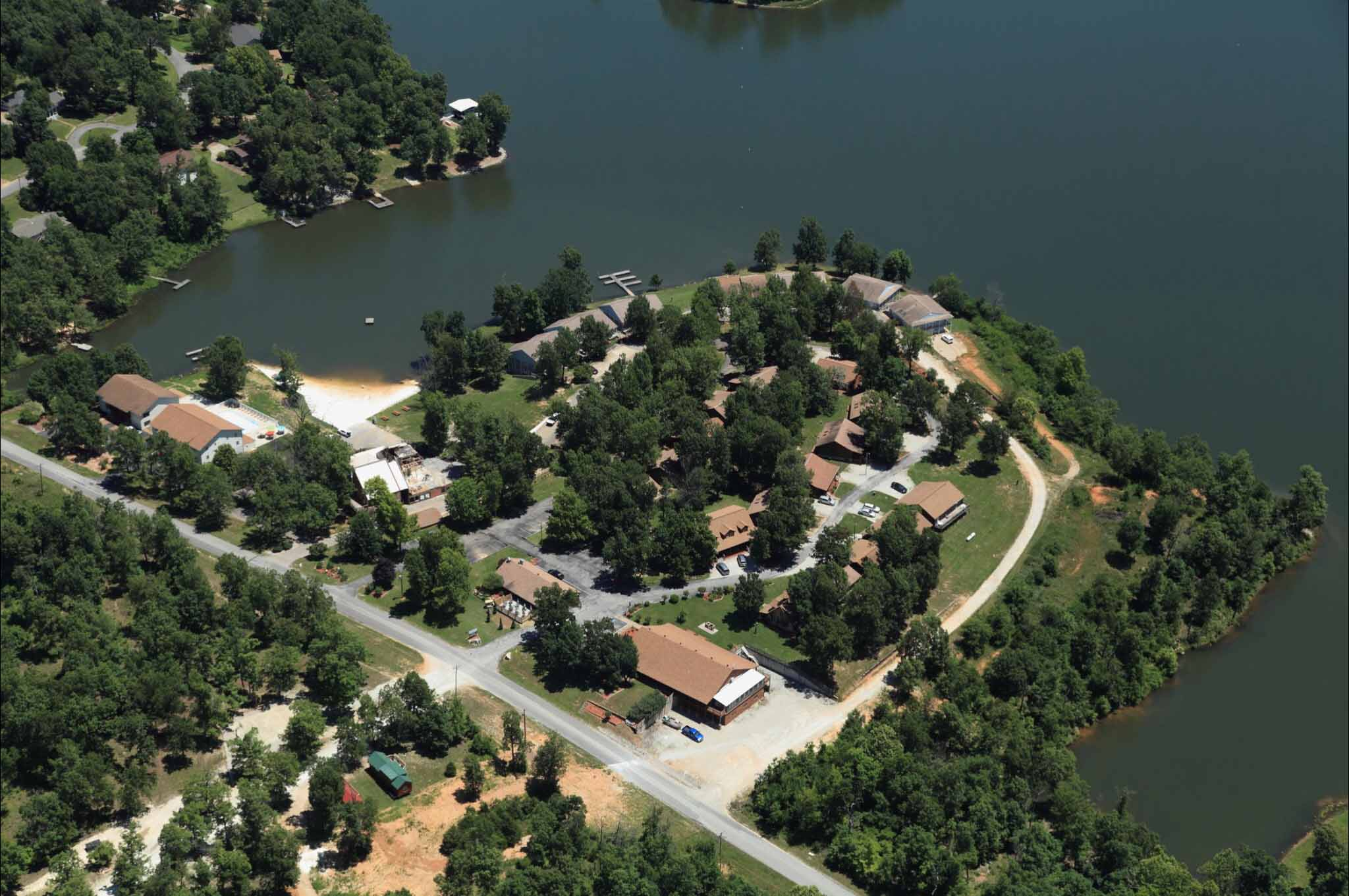 aerial shot of campground on peninsula jutting into lake.
