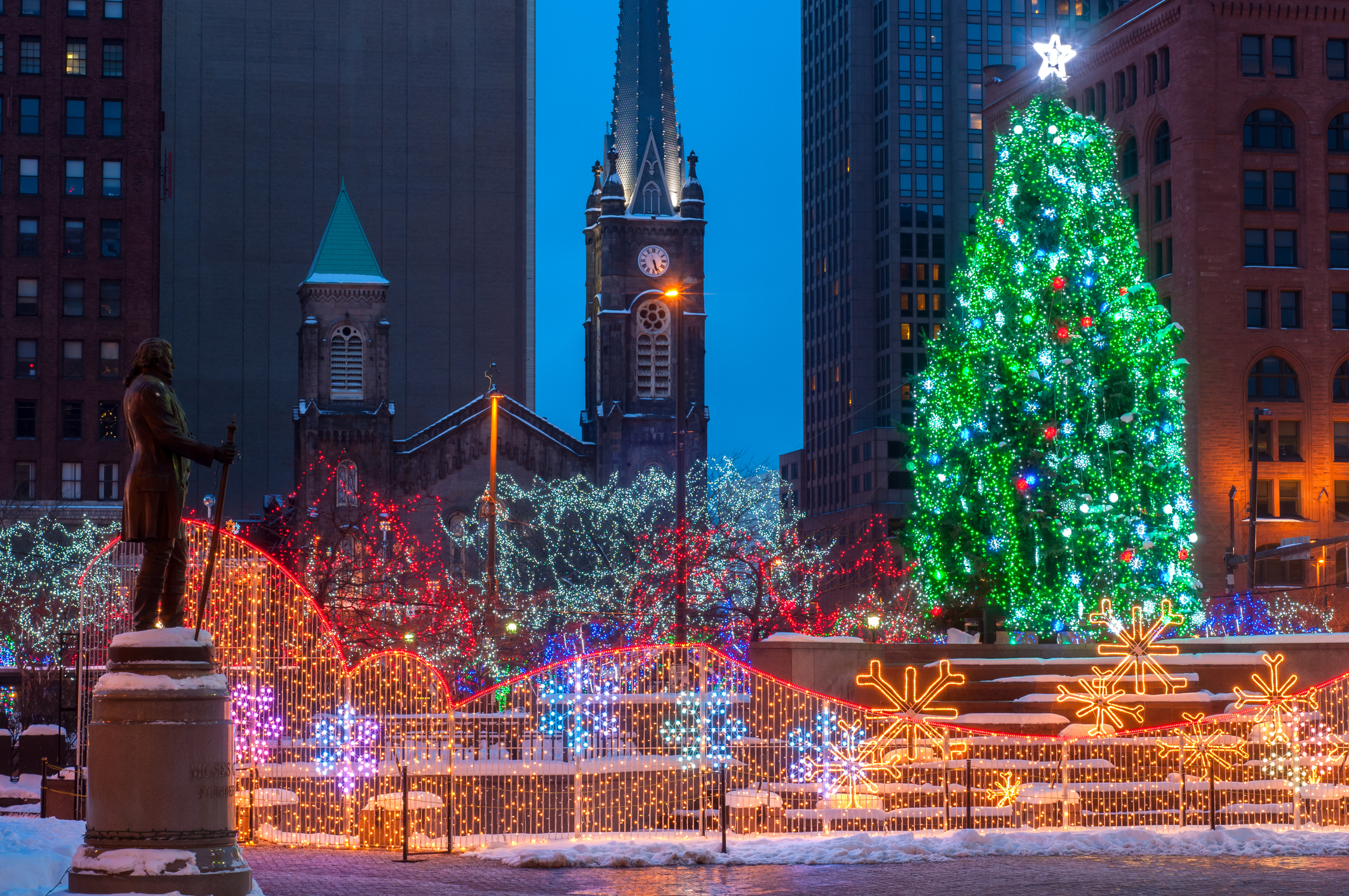 A constellation of holiday lights aglow in a big city square.