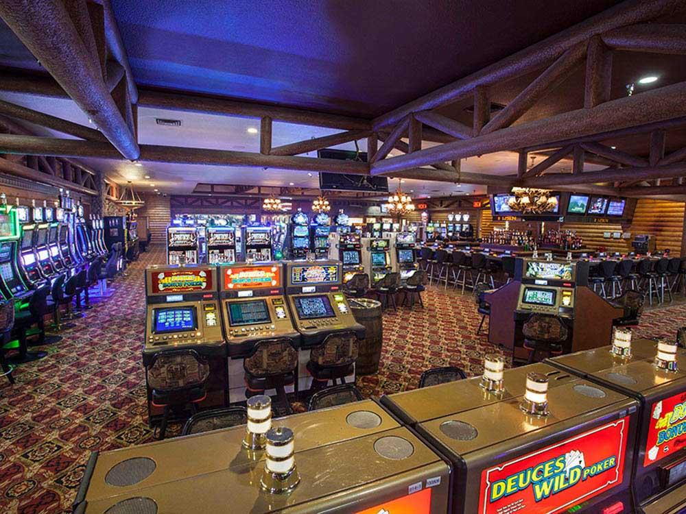 Casino floor with array of machines.