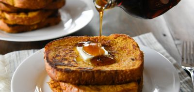 Syrup pouring over stack of French Toast