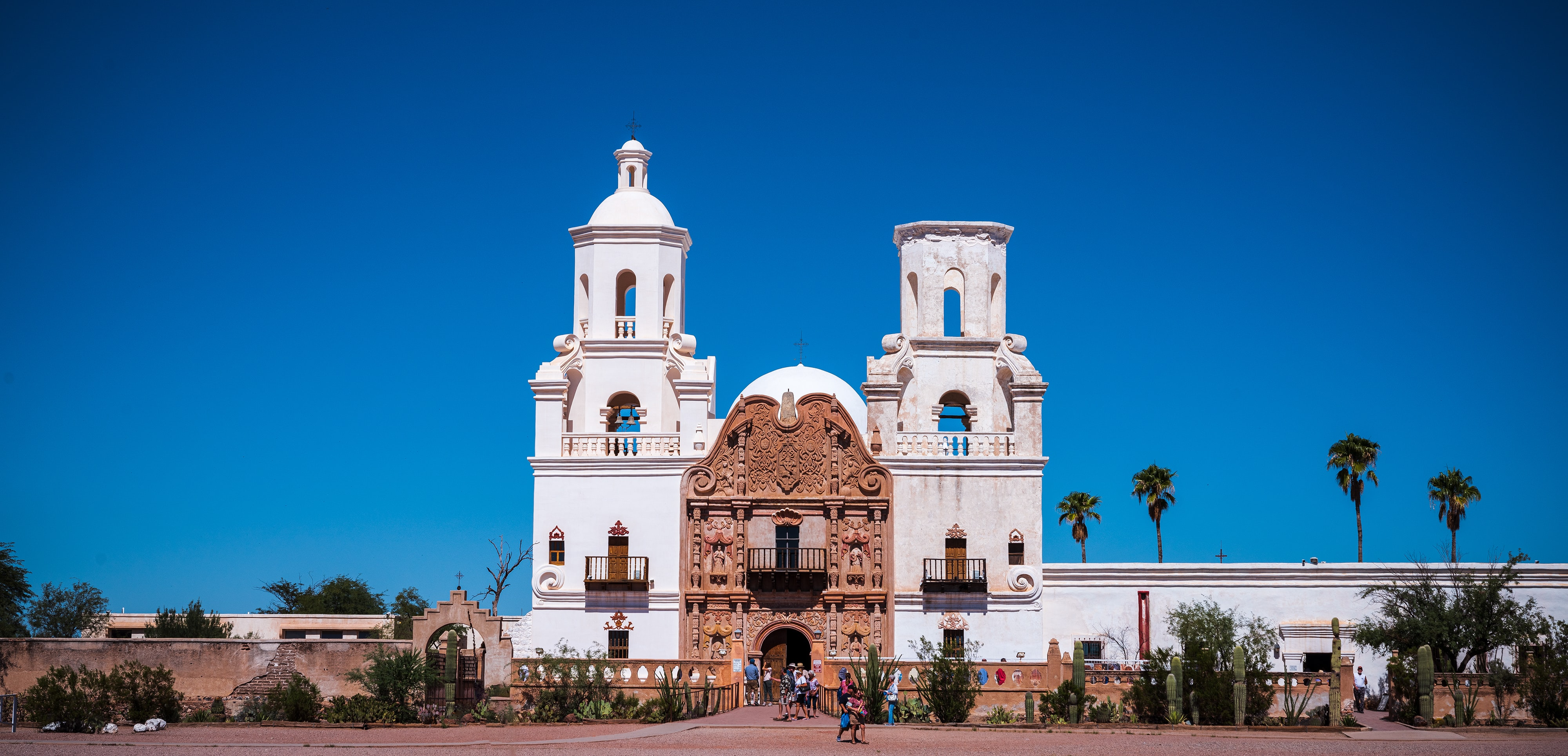 Elegant spanish mission with palm trees.