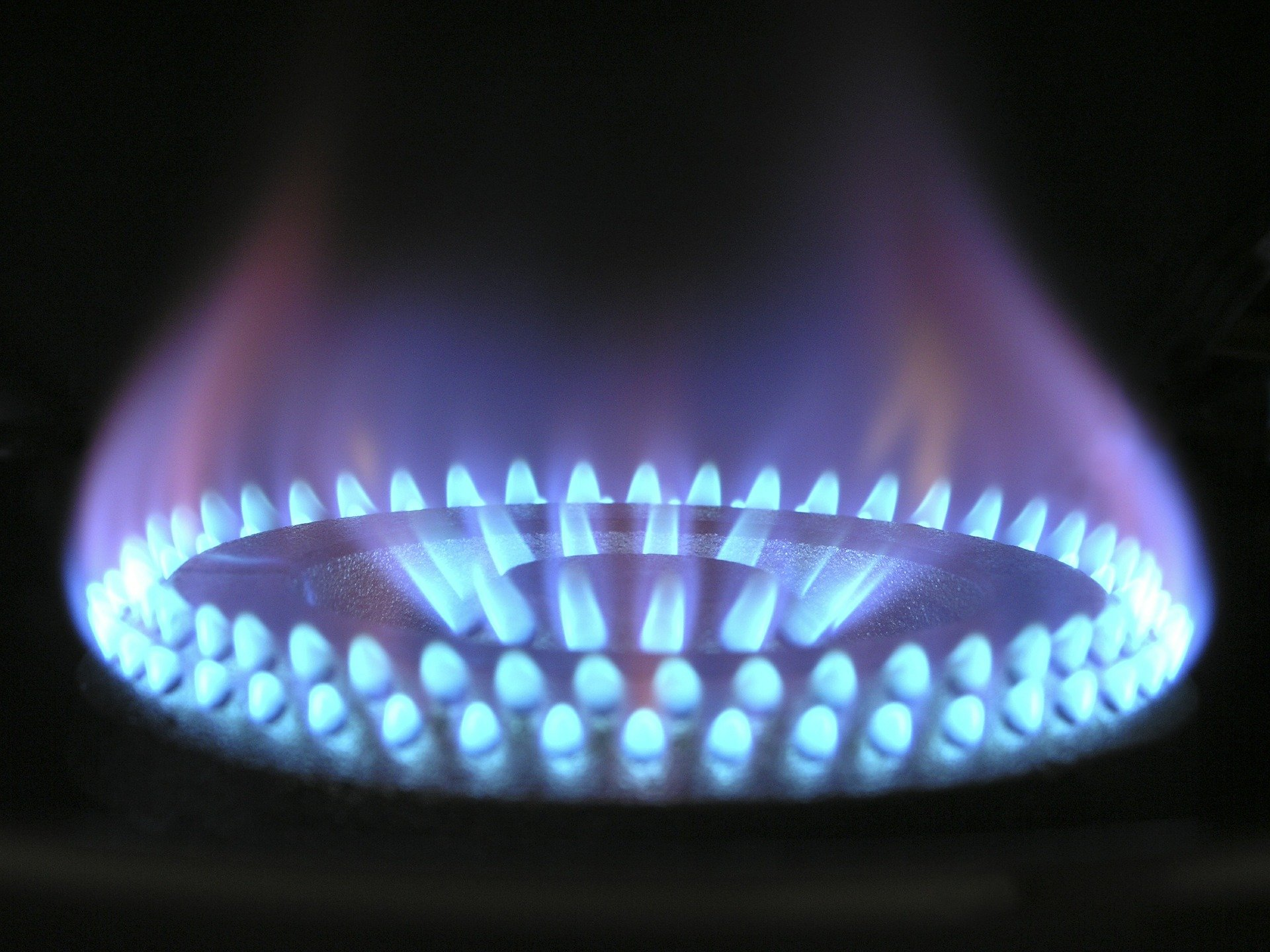 A propane burner with blue flames