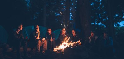 Campers sit around a camp fire at Algonquin Park in Canada