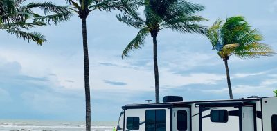 Camping under swaying palm trees on the beach