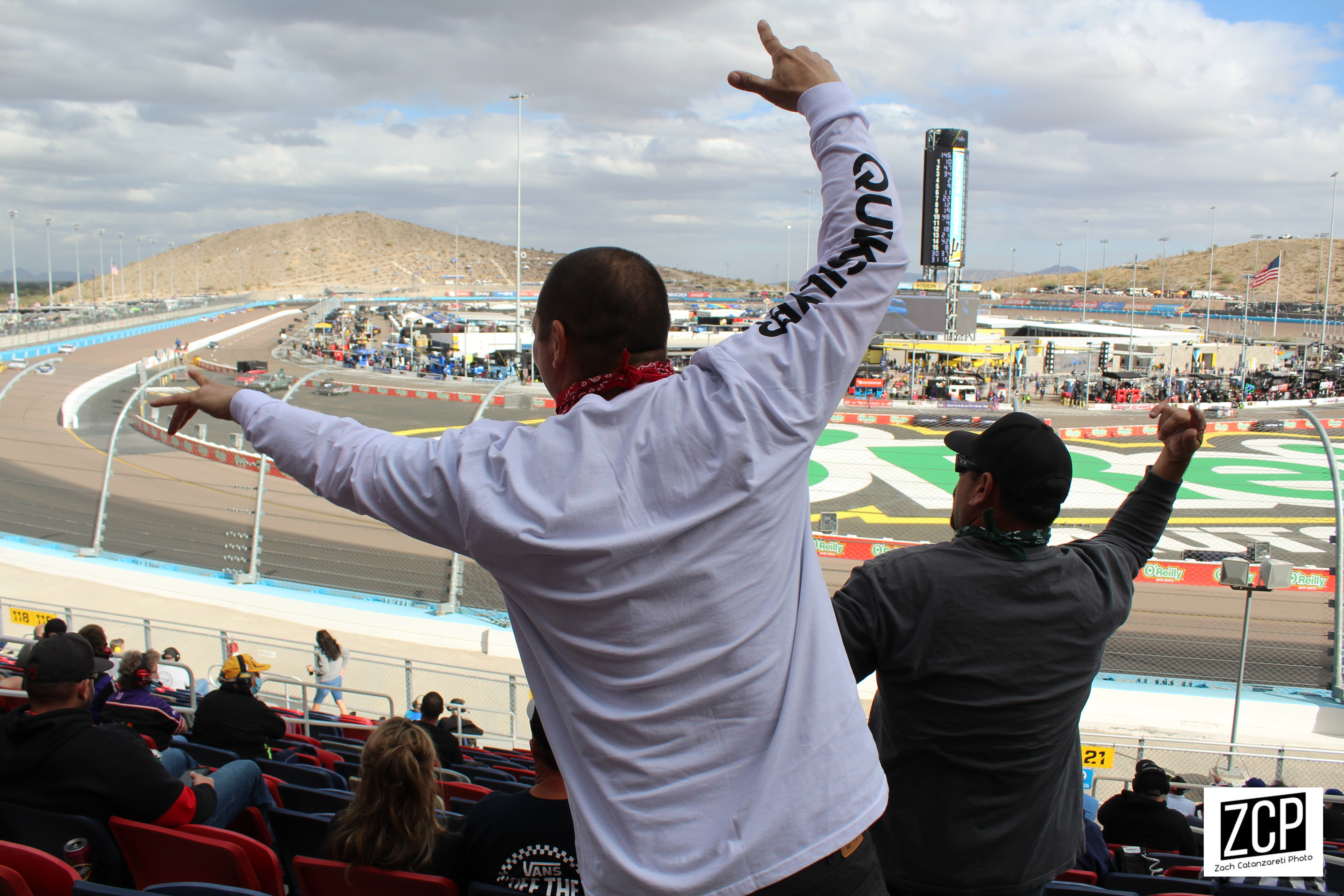 Fans cheer a racing event.
