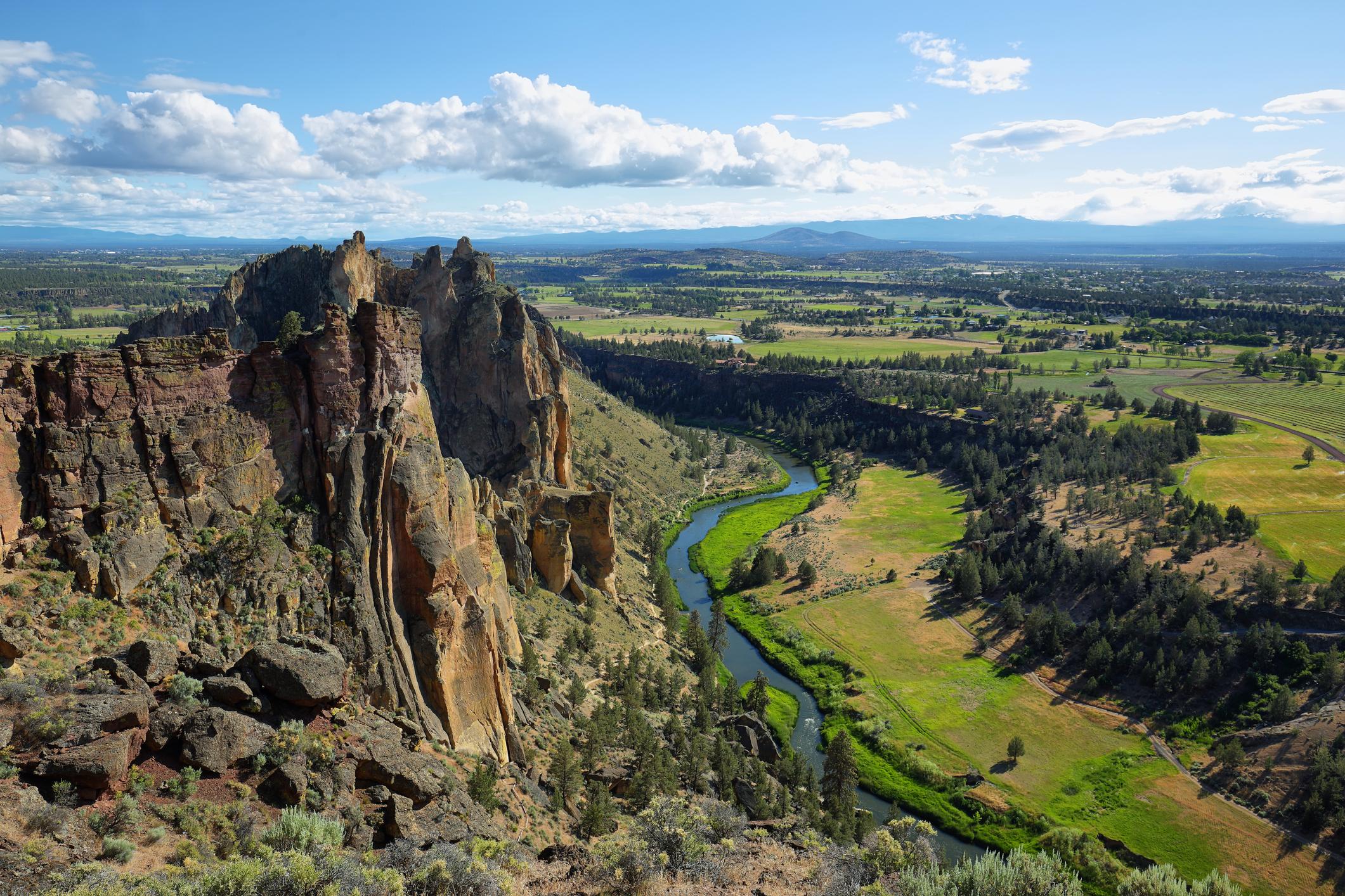 Sheer rock faces overlook a winding river.