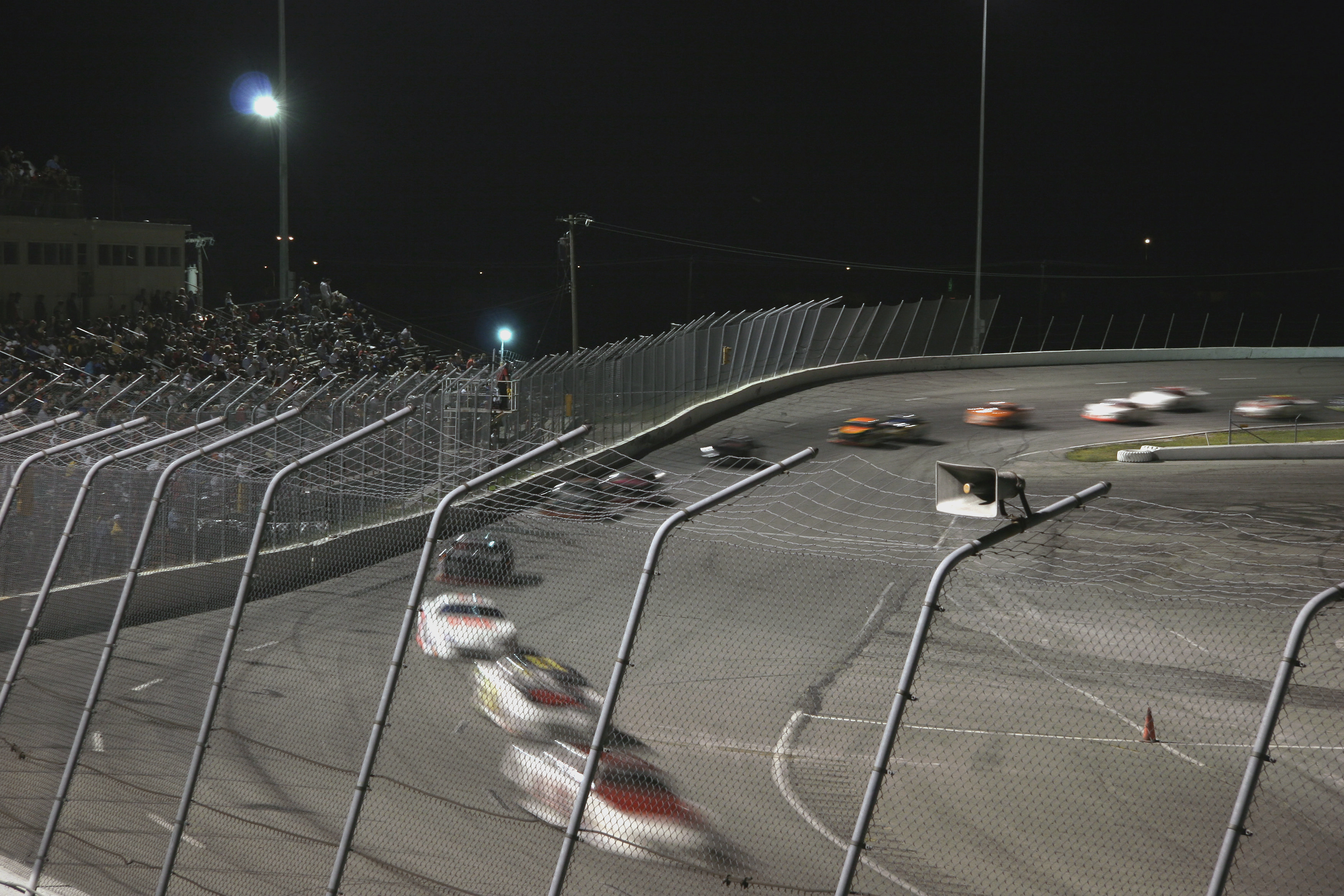 Cars hurtle around a track.