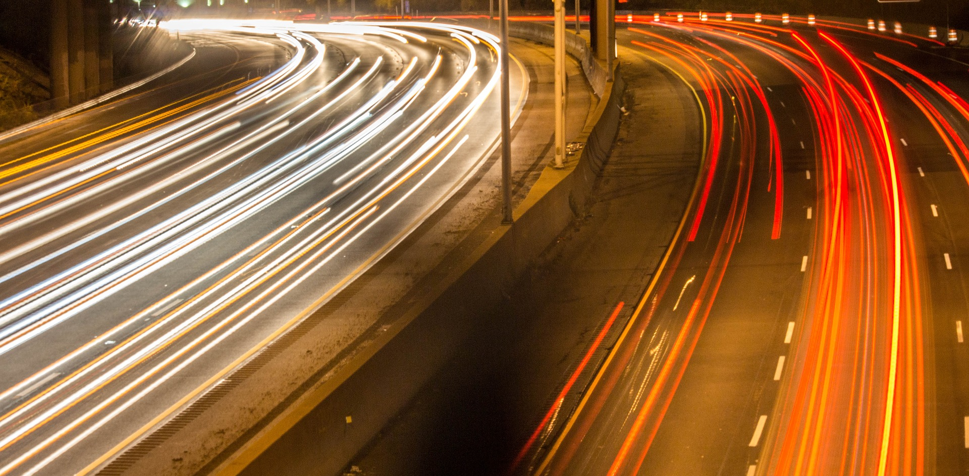 Blurred freeway with lights appearing as streaks.