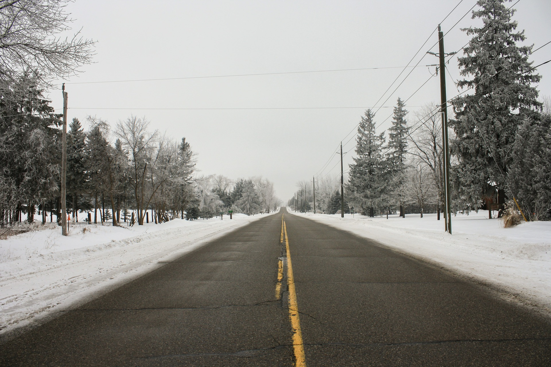 View of highway fringed by heavy snow.