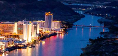 Image of bright casinos during evening on the river.