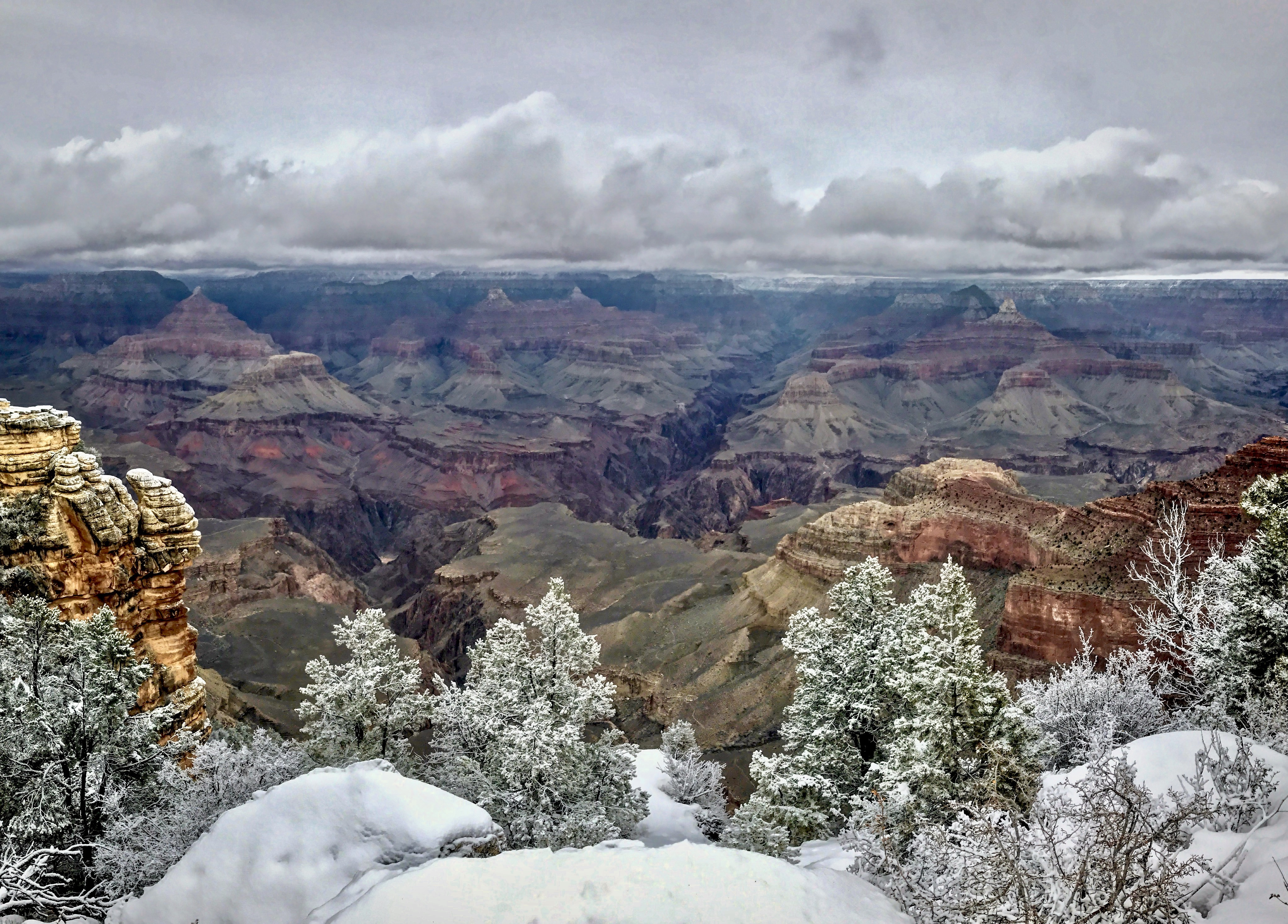 A dusting of snow over cliffs and mesas.
