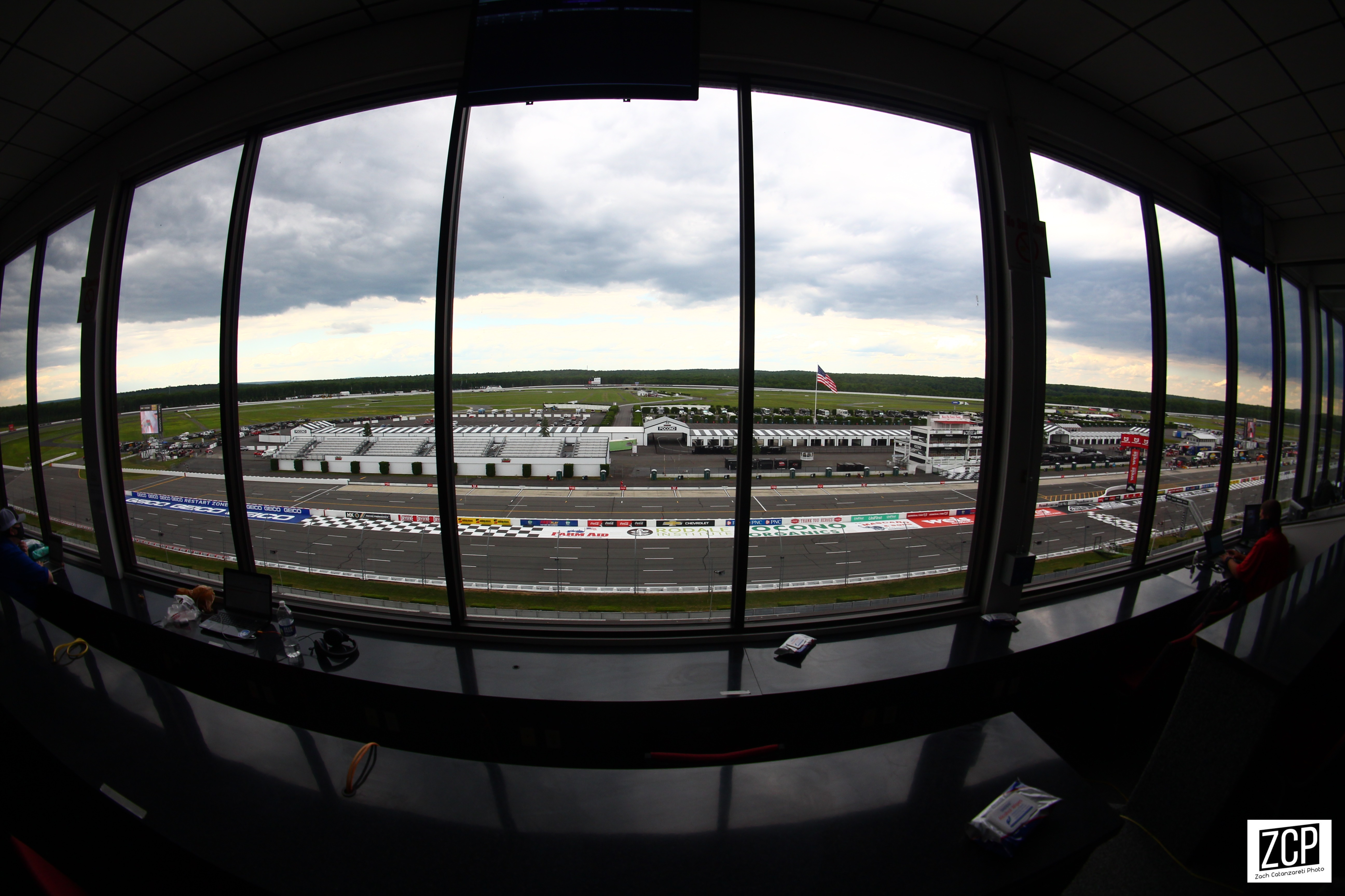 Fish-eye lense shot of window looking down at racetrack.