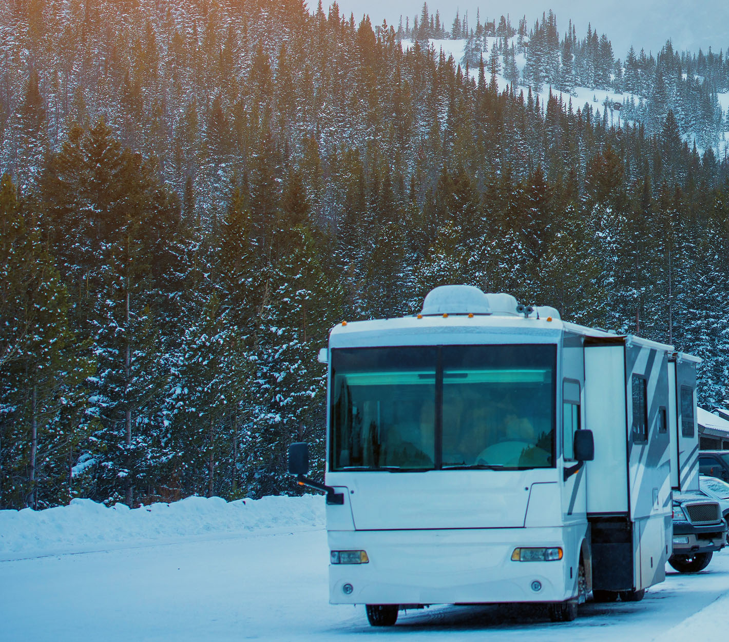 RV with ski run in the background.