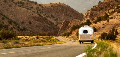 Airstream driving down a desert road