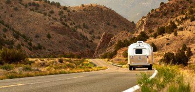 Airstream driving down a desert road