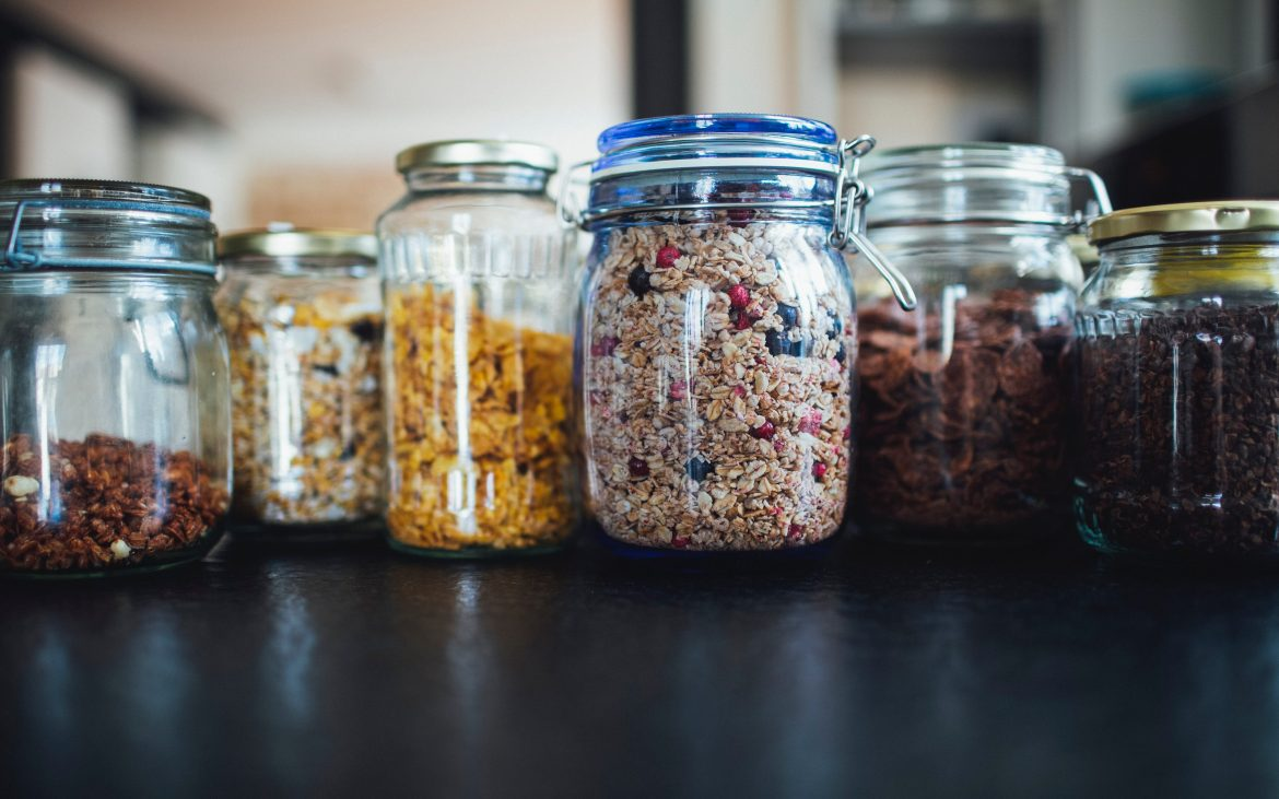 Glass jars with cereal inside
