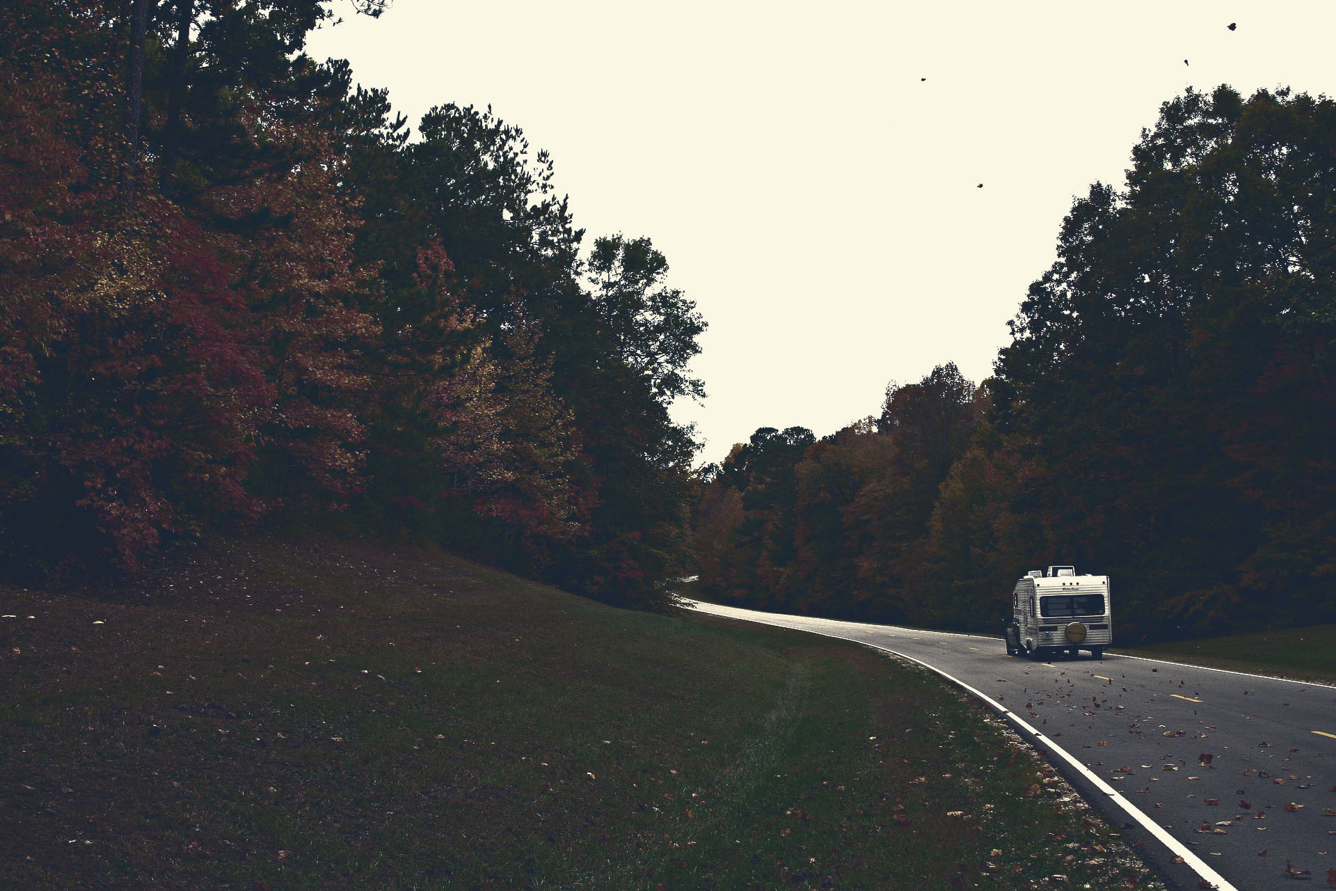 RV on dusk road.