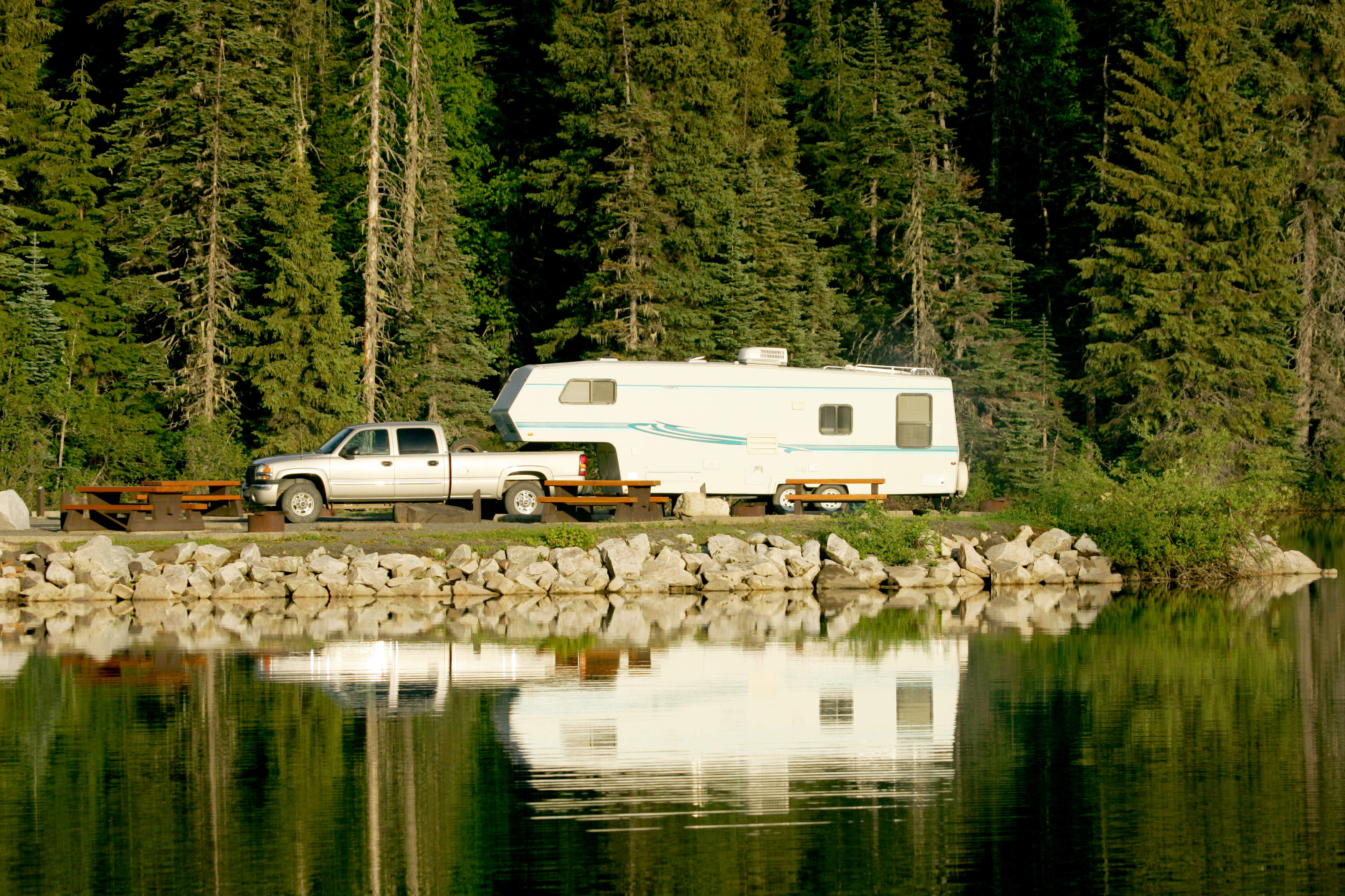 Perfect camping -- an RV camping alongside a lake