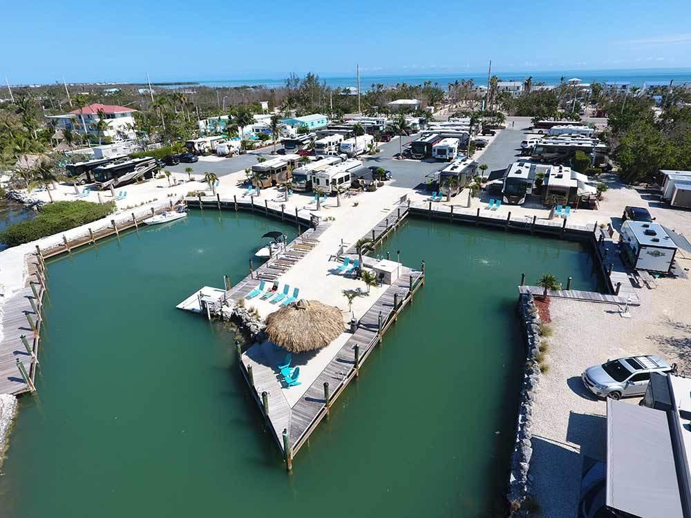 waterfront Good Sam Parks RVs parked near a small marina