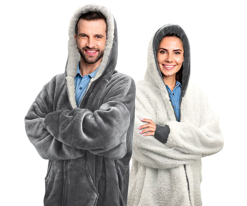 Man and woman dressed in blanket hoodies