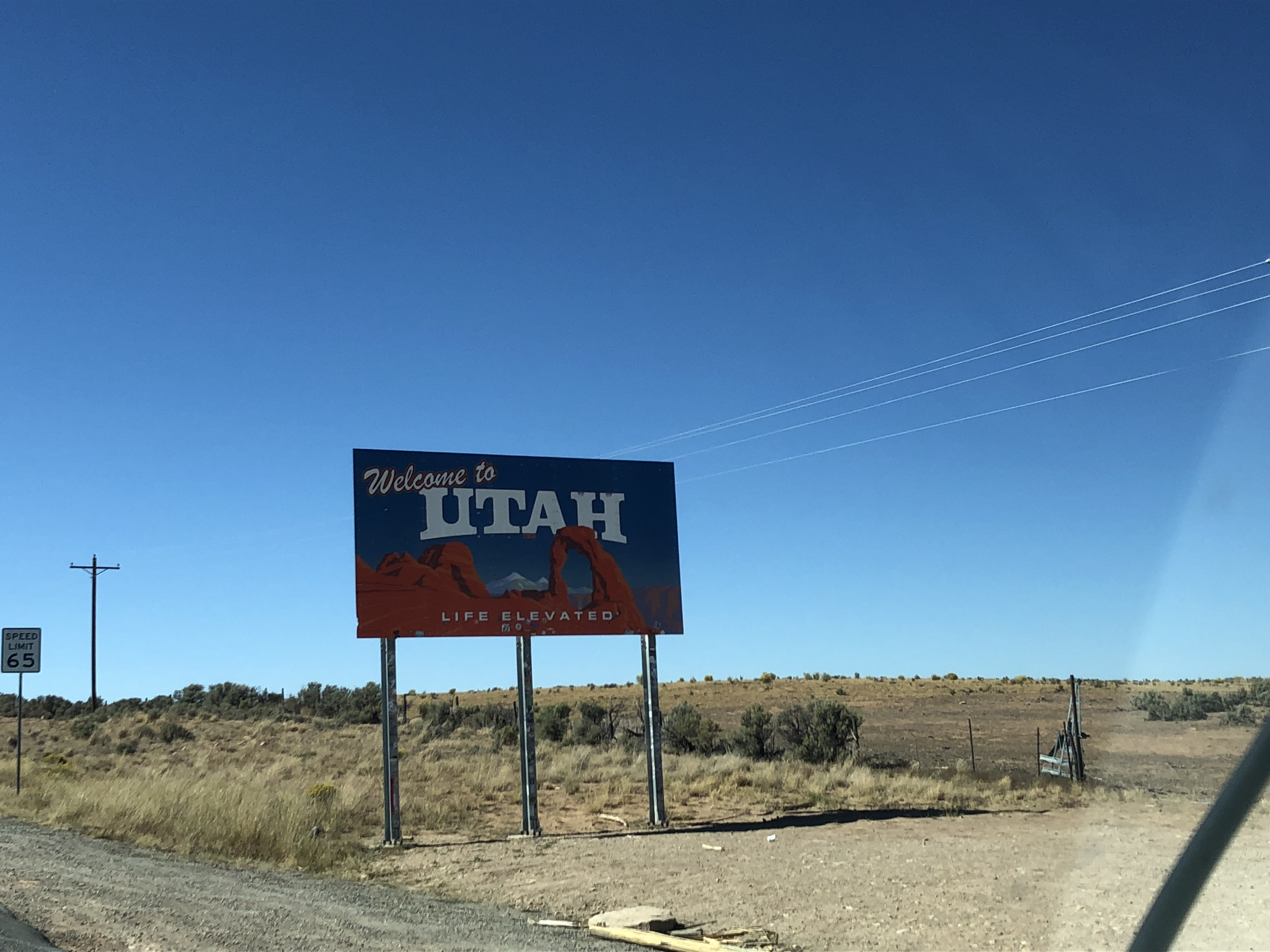Sign promoting Utah against clear blue sky