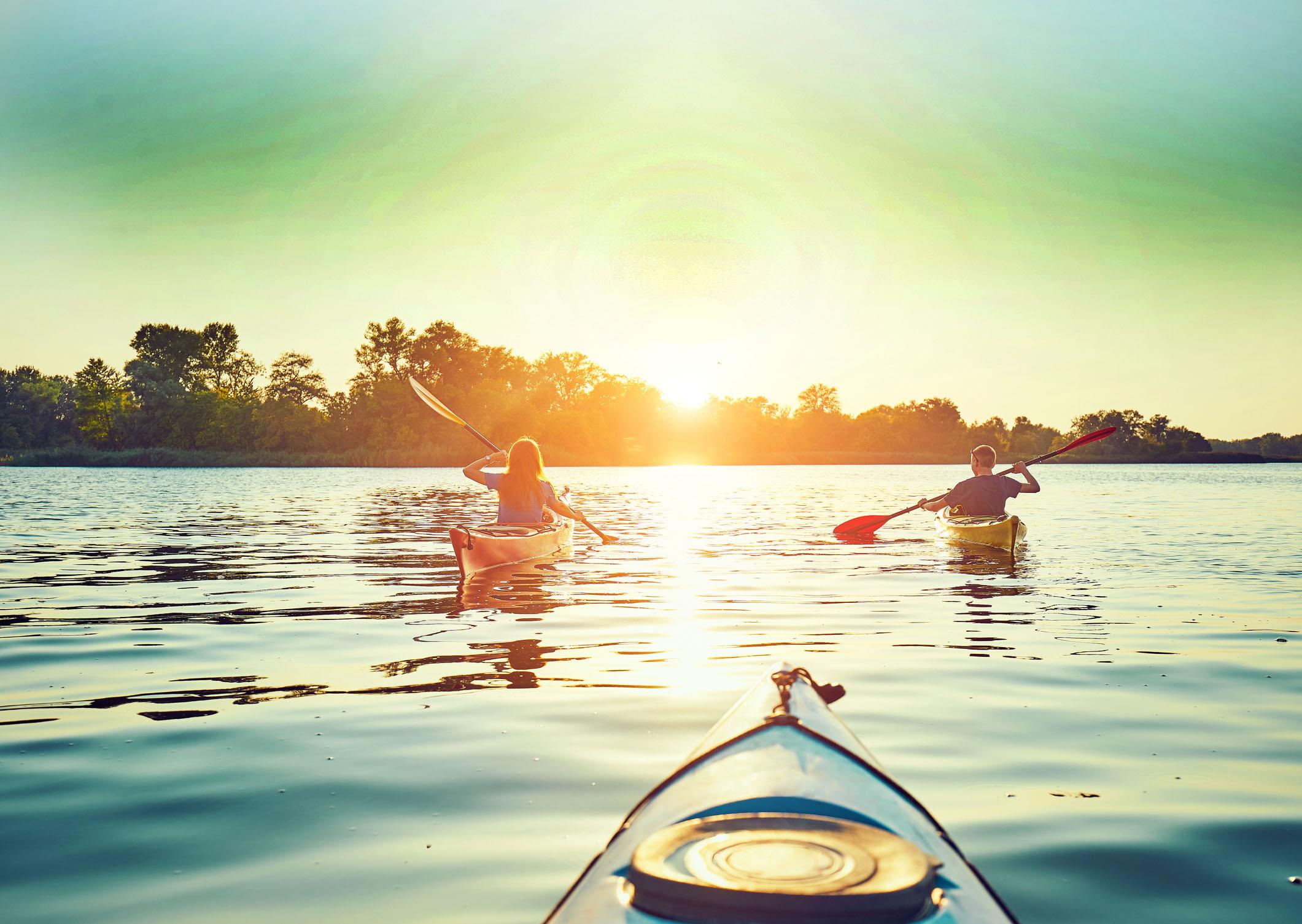 A pair of kayakers heading toward Sunset
