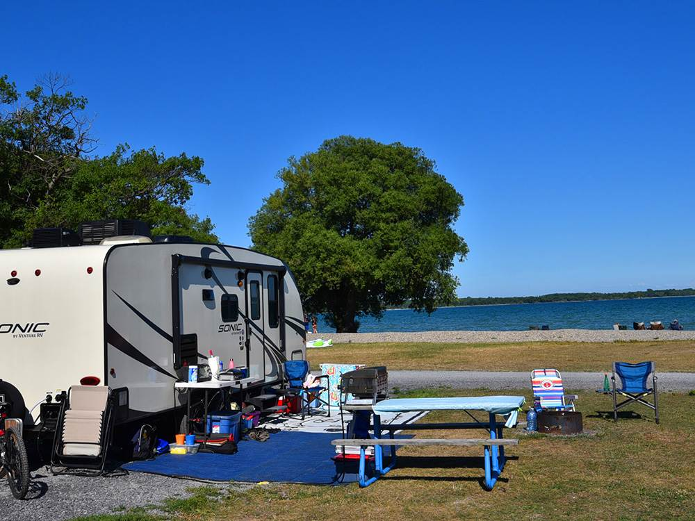 waterfront Good Sam Parks A fifth-wheel parked near a lake shore