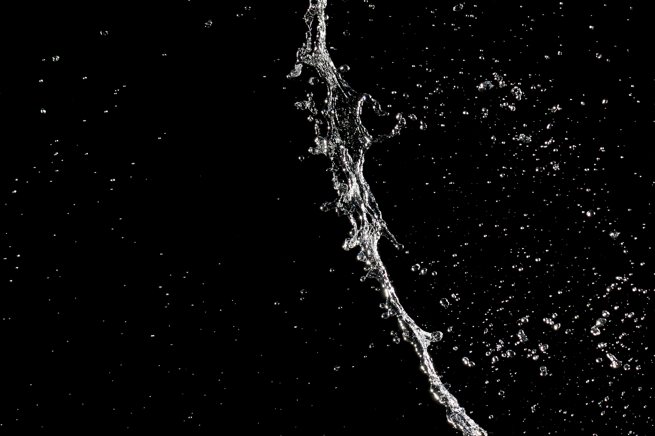 Water splashing against a black background.