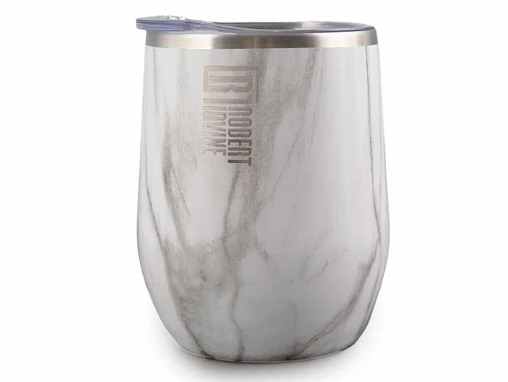 Tumbler glass with marbled exterior