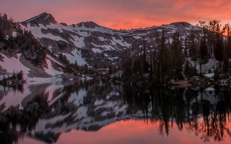 Wallowa Mountains and lake with pink and orange sunset