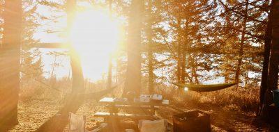 Picnic bench and camping gear near lake in Grand Teton National Park