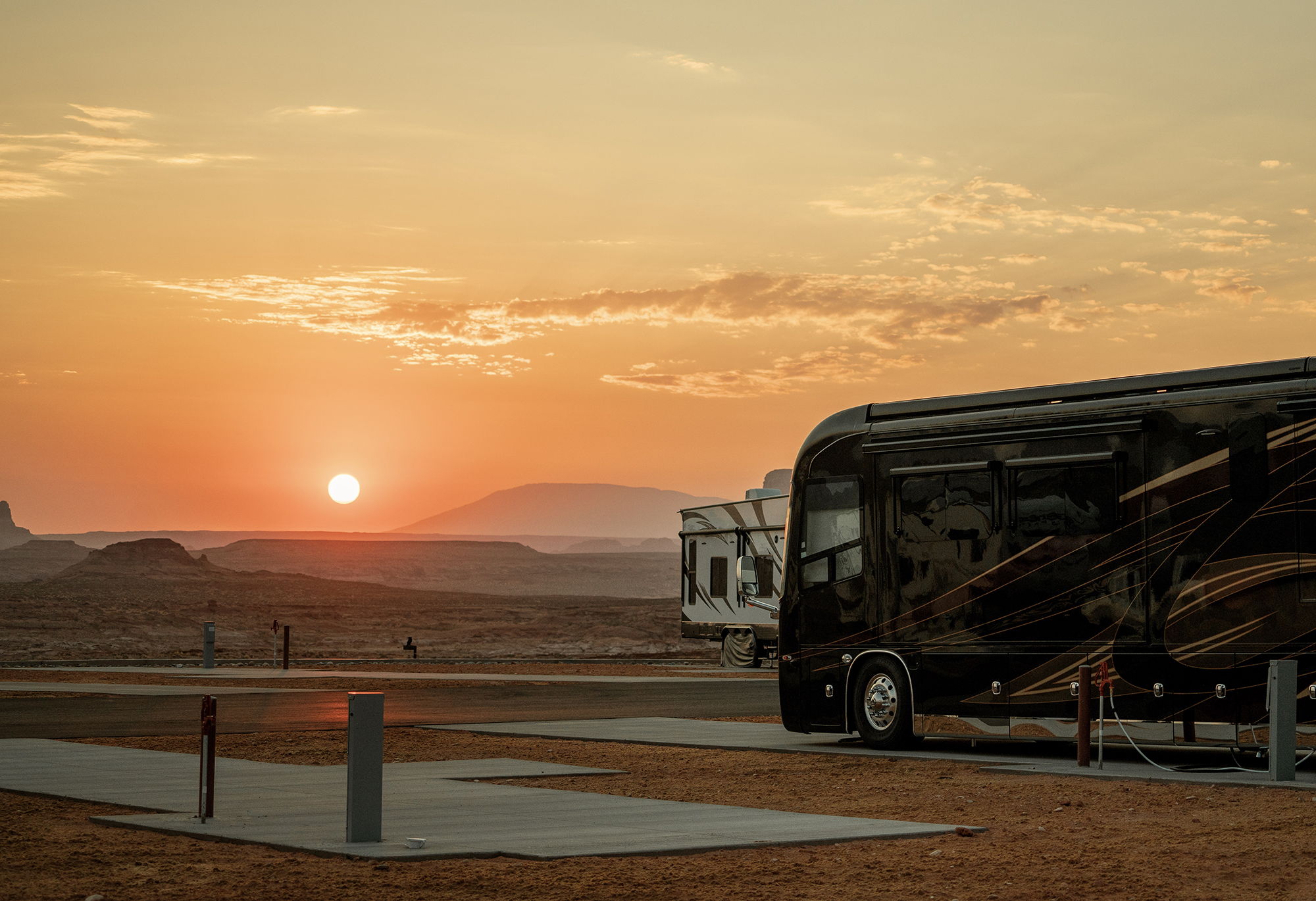 Lake Powell — RVs parked at desert sunset.