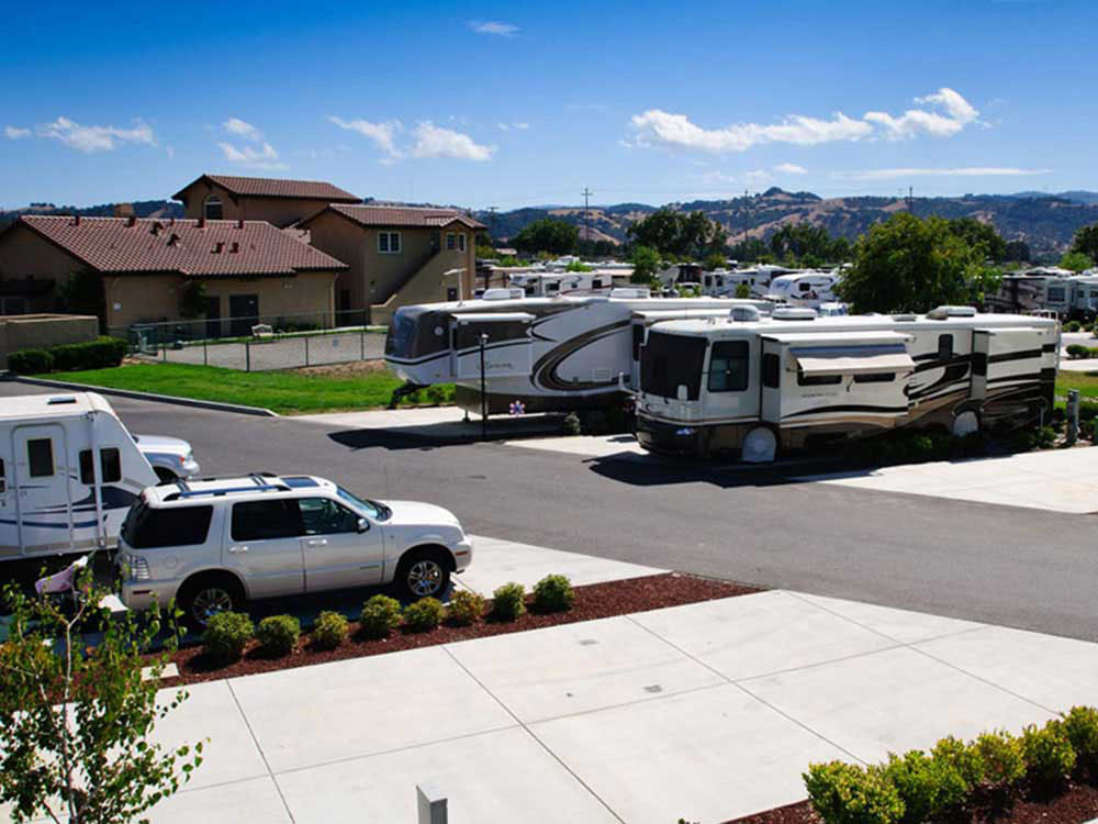 RVs and cars parked near a clubhouse