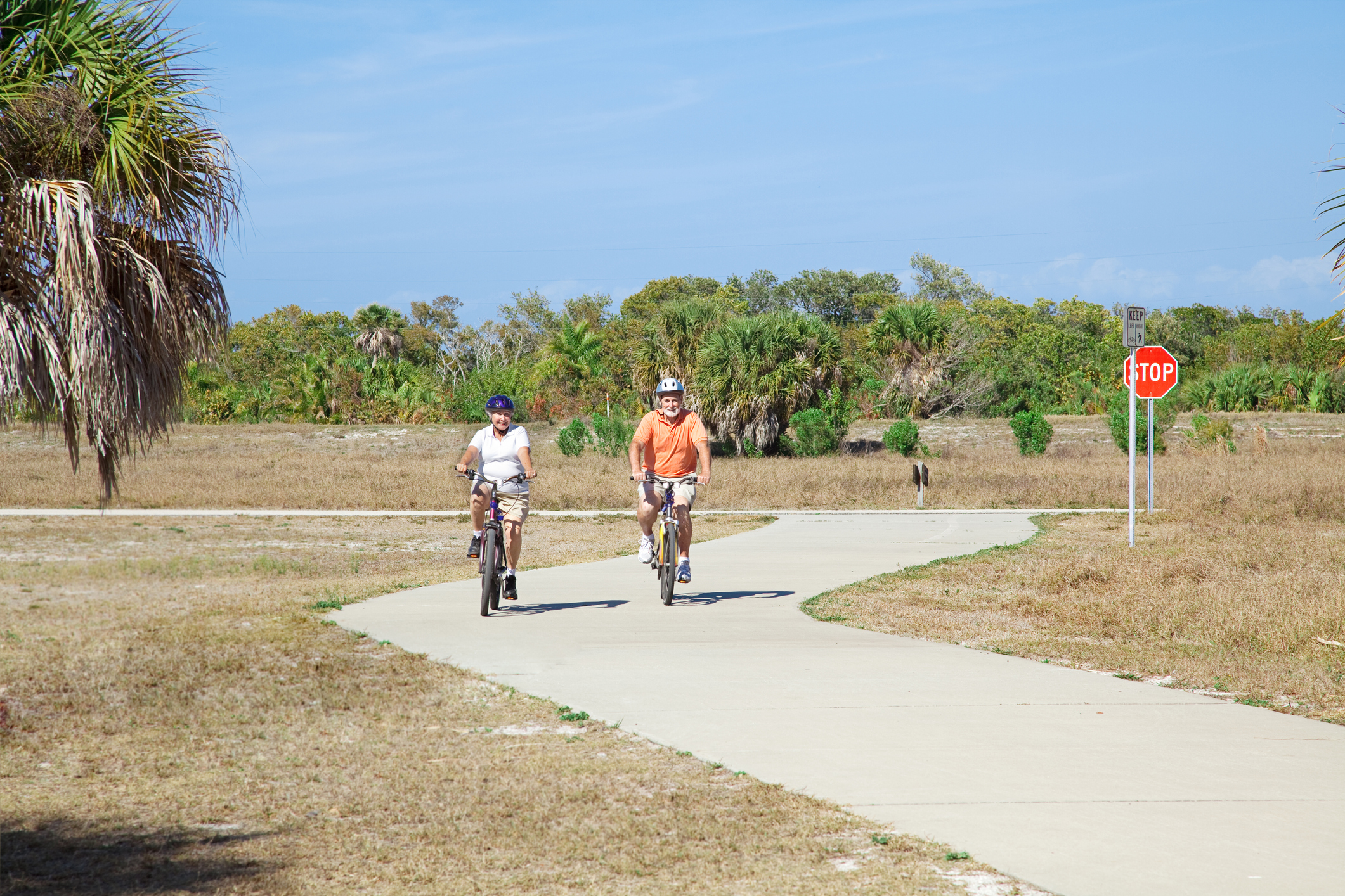 A senior couple riding a trail