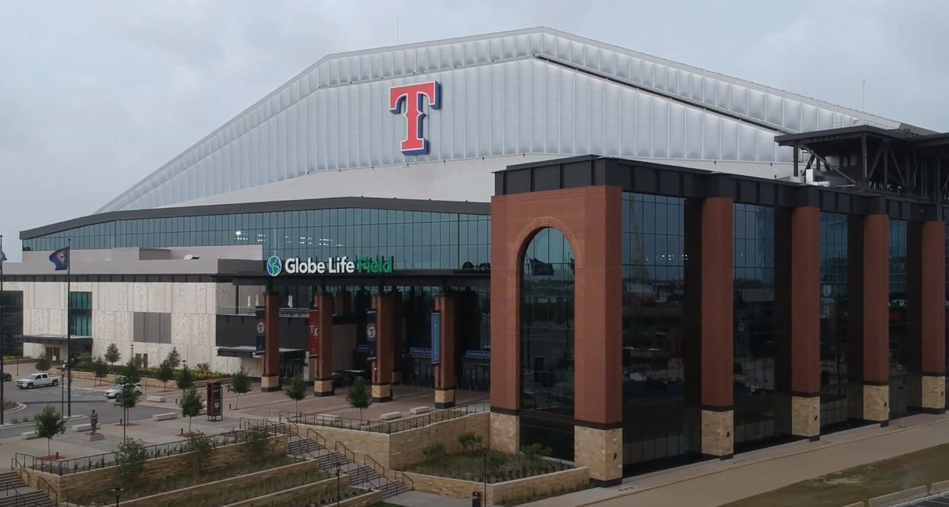 """Stadium with a big """"T"""" emblazoned over the entrance."""