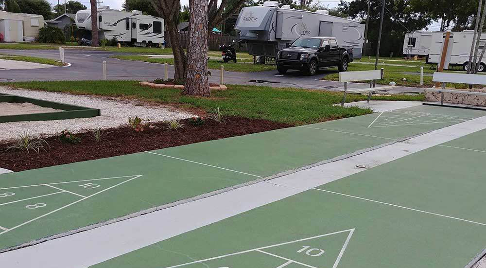 RVs in background, shuffleboard court in foregrond.