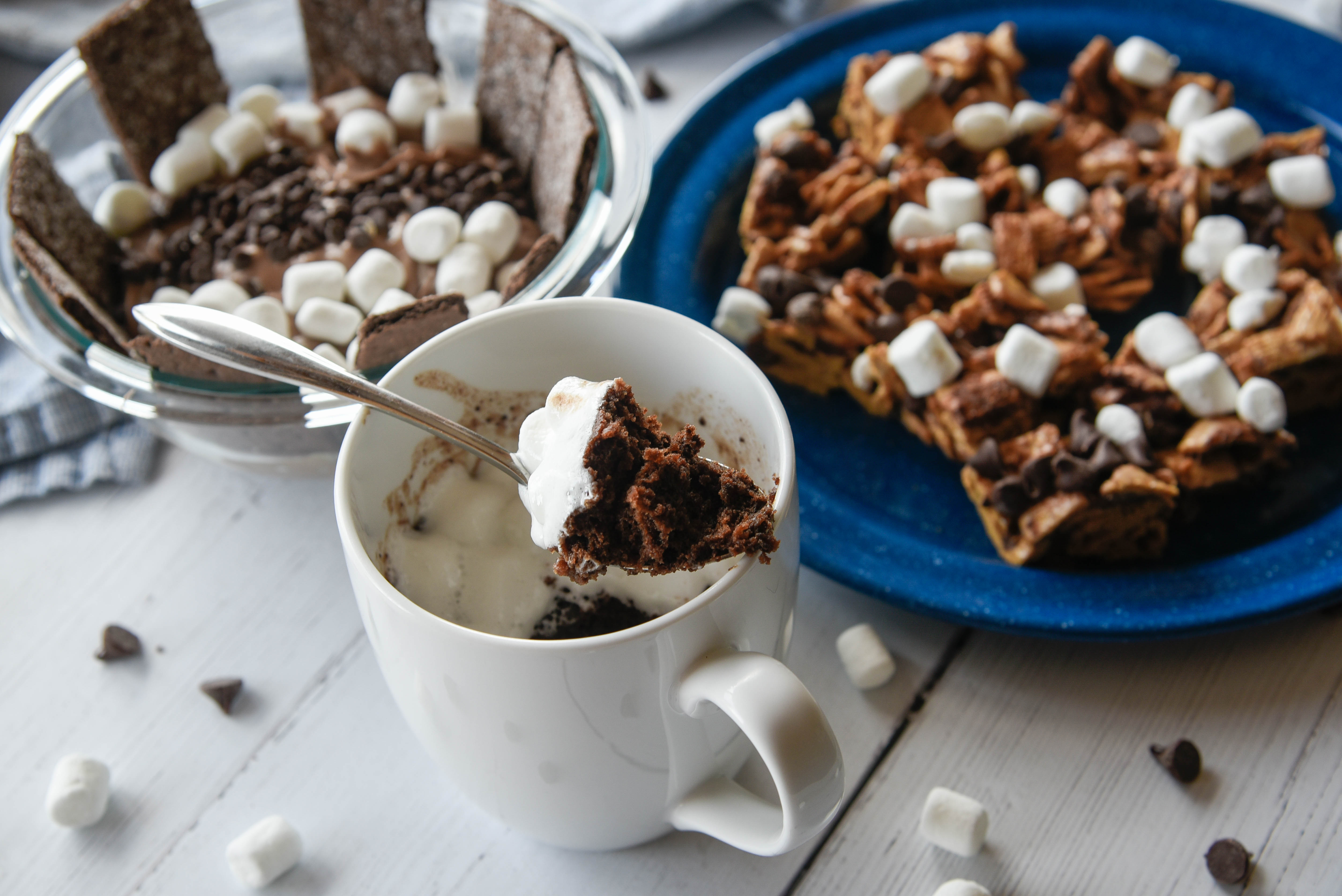 A cup of gooey cake with s'mores bars and dip