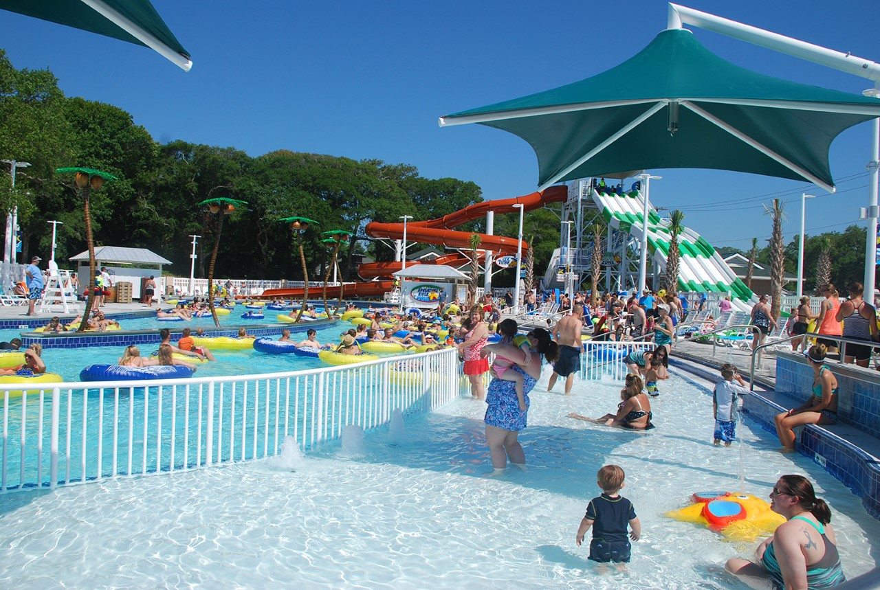 People gather near a pool and lazy river.