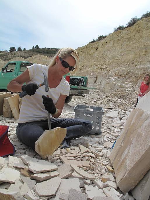 Chiseling a rock at a Kemmerer quarry.