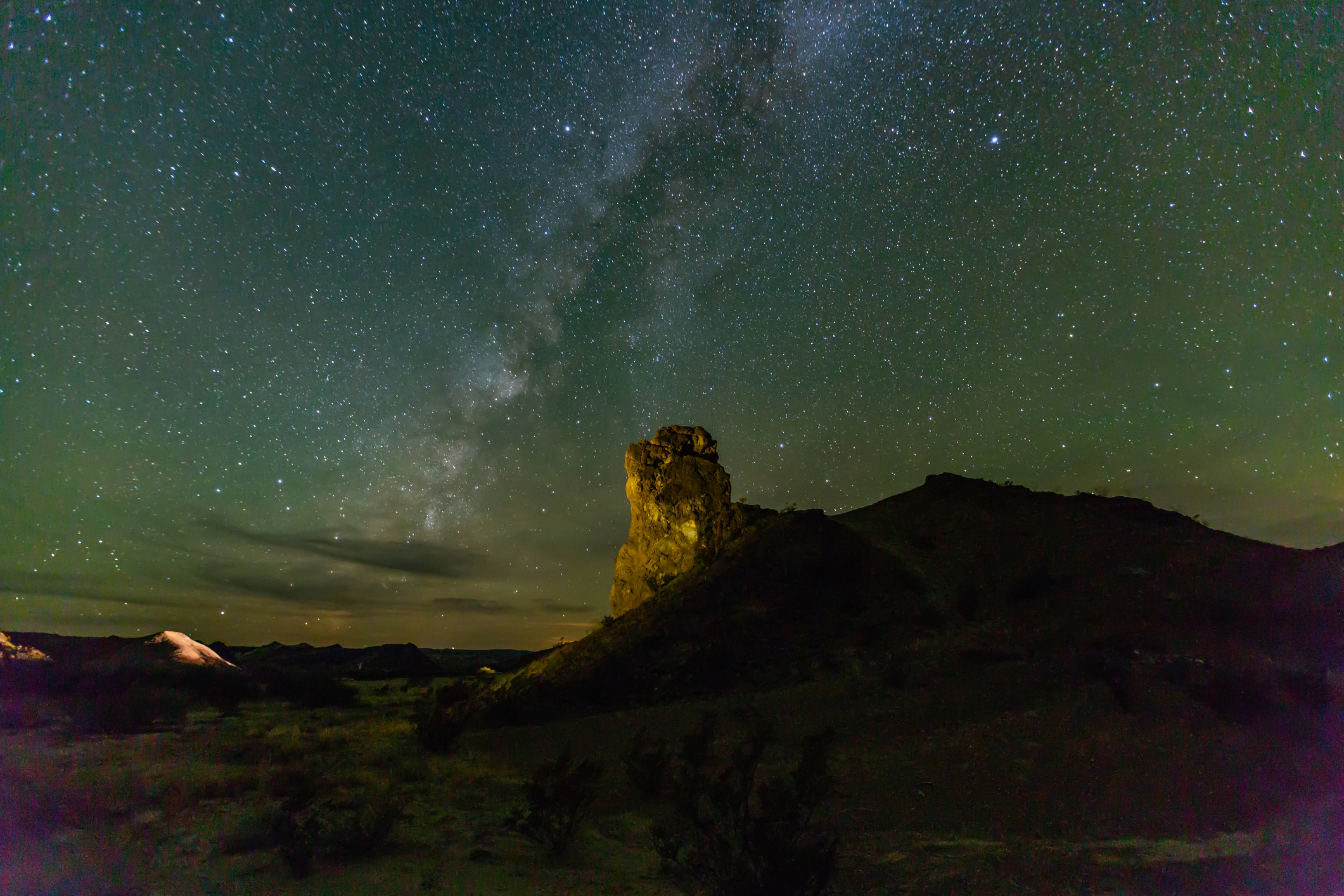 Milky Way rises over a rugged rock formation