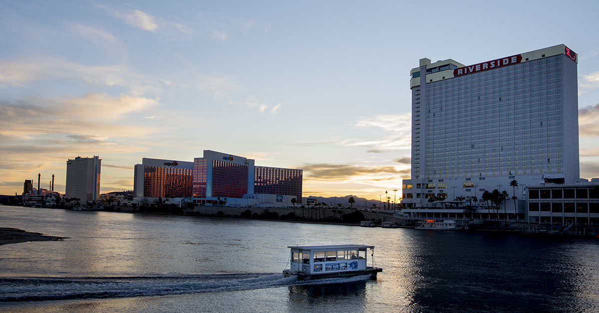 Perfect for Getaways — A water taxi crosses a river toward a large casino