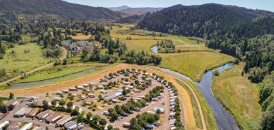Brookhollow RV Park is a well-kept secret — Aerial shot fo an RV park on the banks of a river.