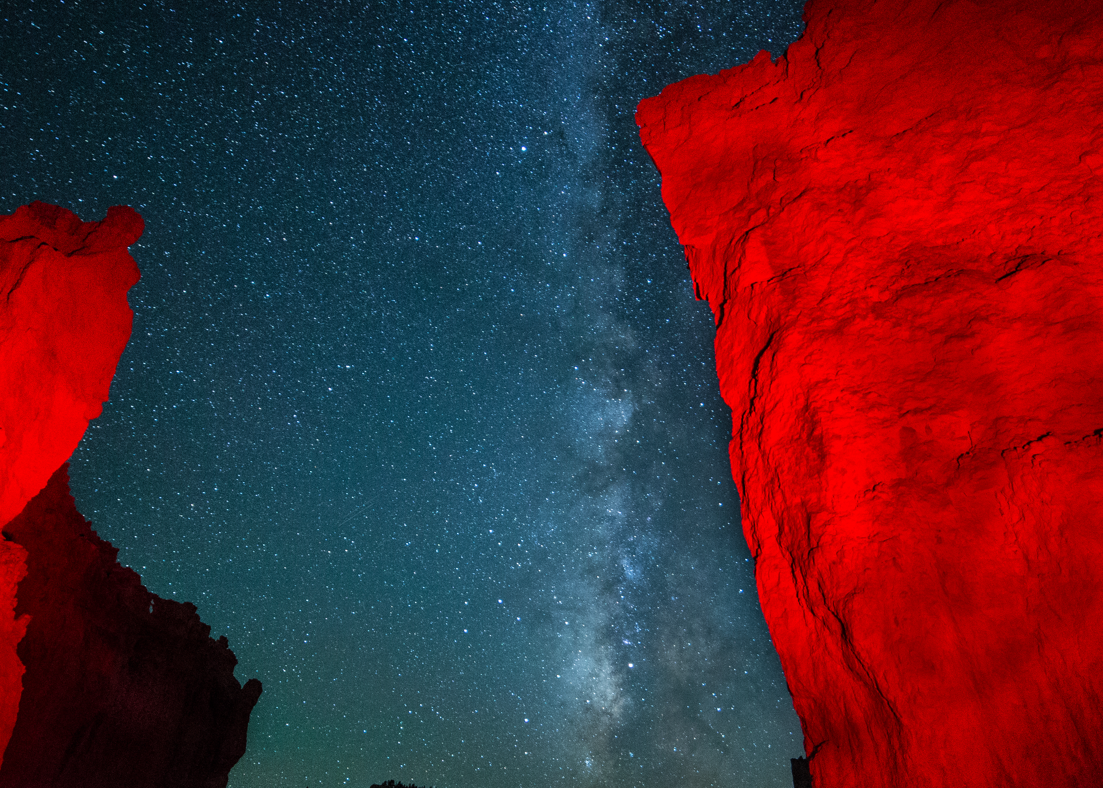Orange hoodoo against a night sky with the Milky Way