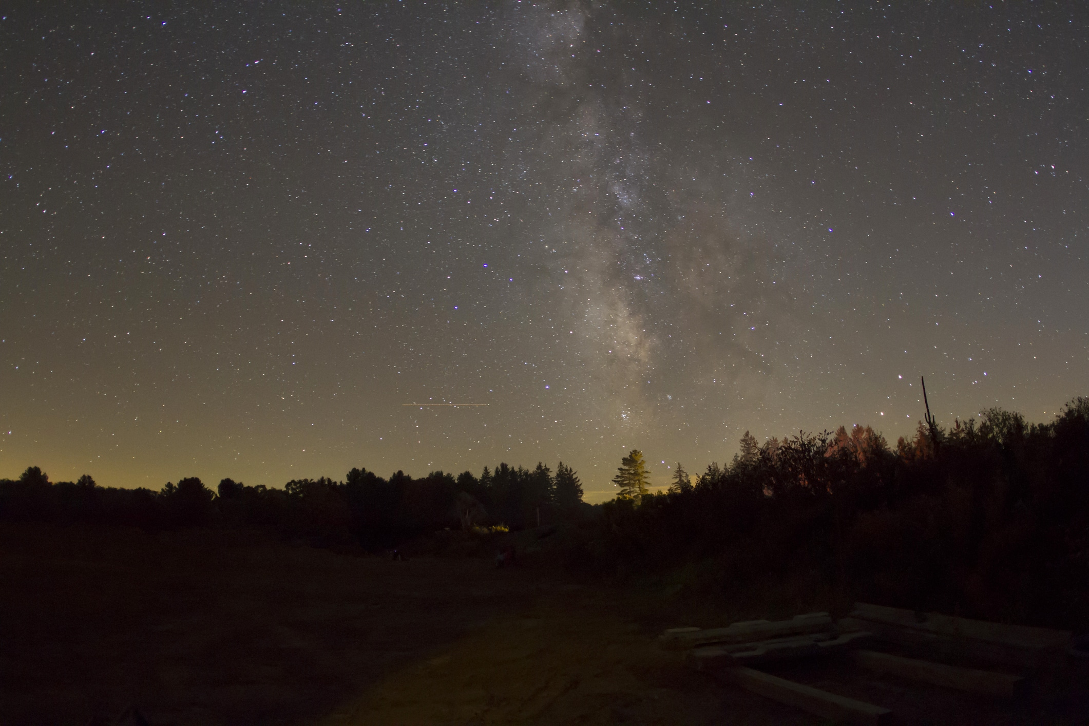 Stars rise like a pillar on the horizon.