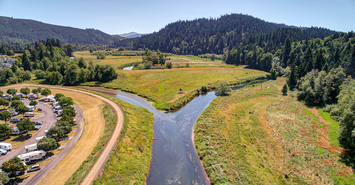 Aerial shot of river forking near RV park.