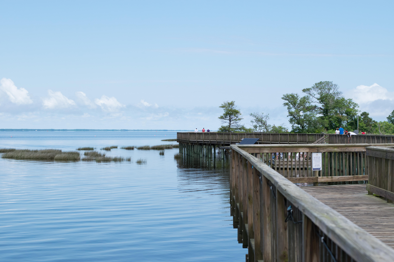 Wooden walkways overlooking a shoreline.