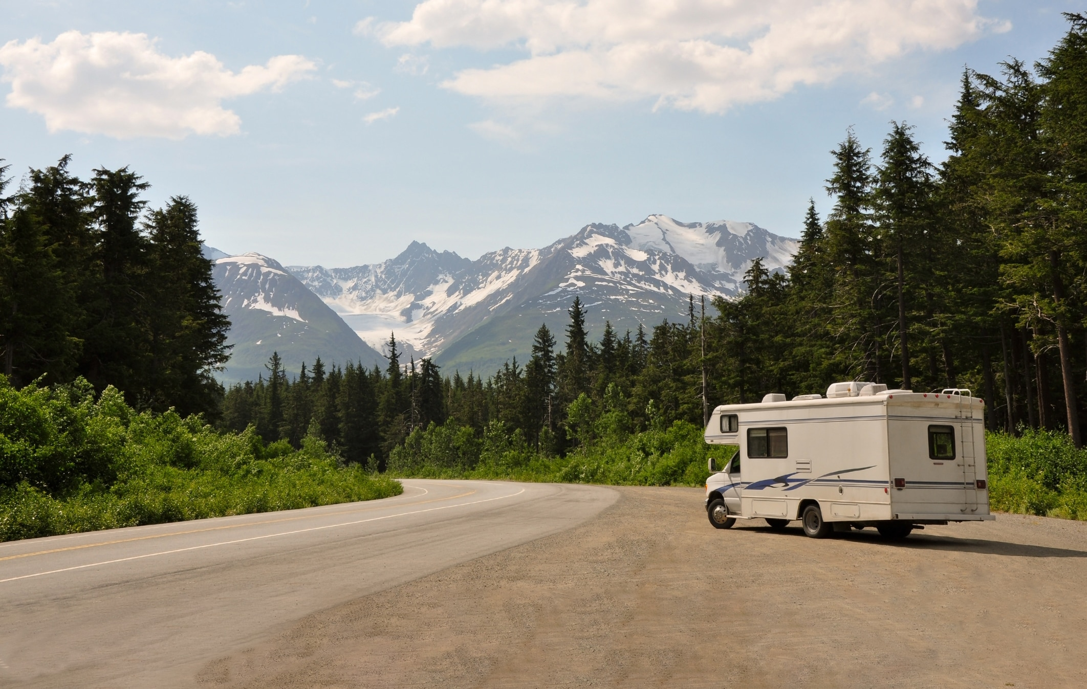 RV parked on the side of a highway ready to roll.