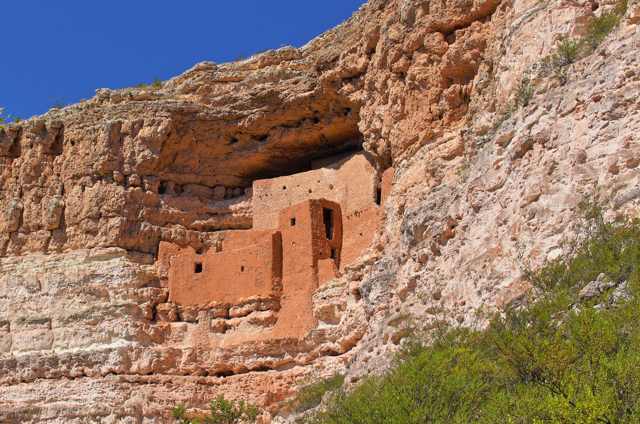 A pueblo complex on a rock face.