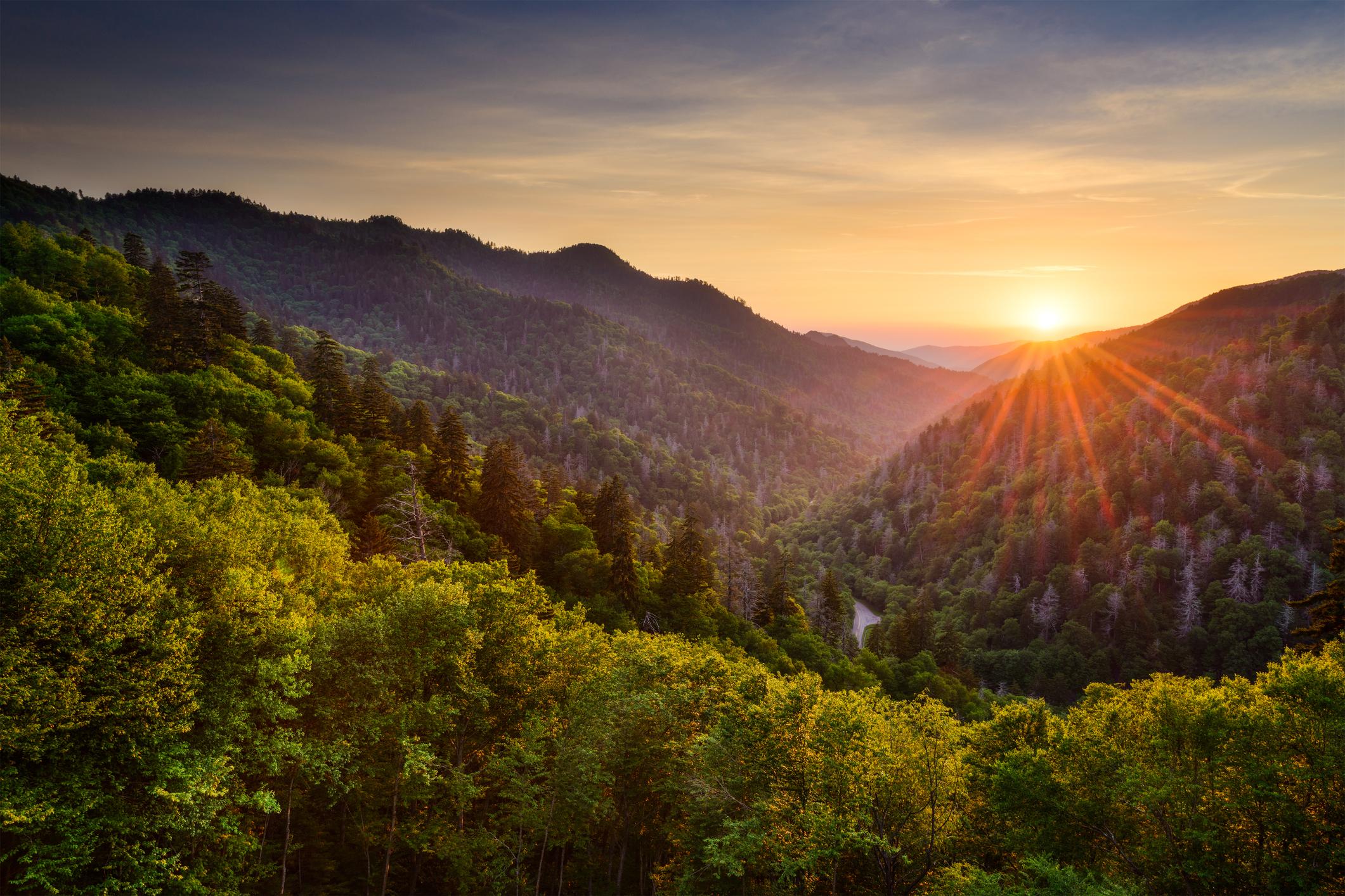 Sunset over a vast mountain range.