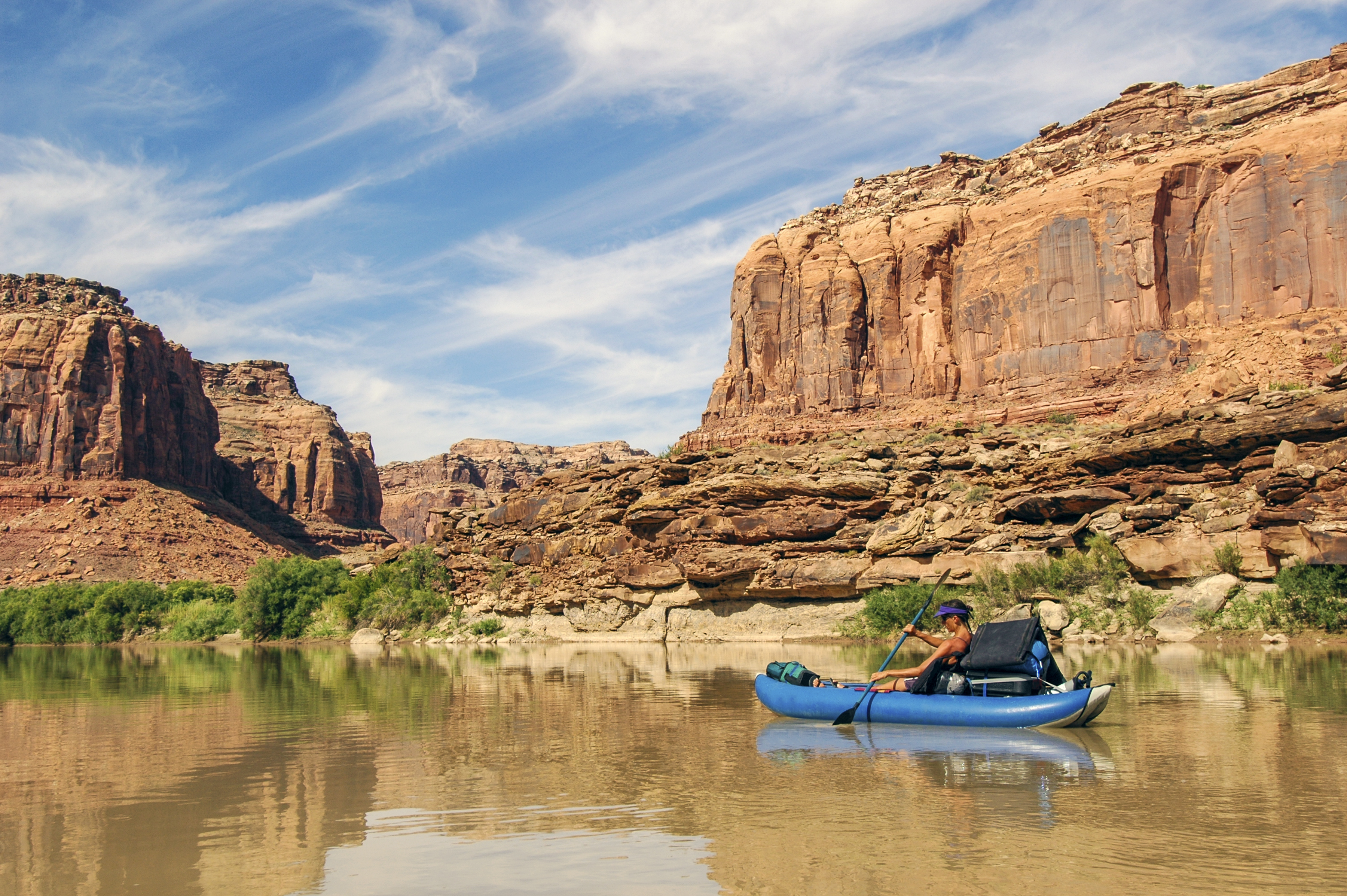 Leisurely kayak on a river lined with sheer rock faces.